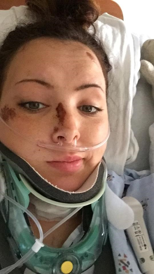 woman in hospital with neck brace